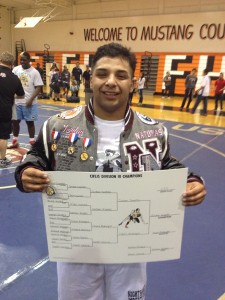 Natomas senior Jordan Sepeda wins D-III title at 220 pounds. Photo: T. Horn
