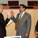 Assemblymember Roger Dickinson swears in Phil Serna who is accompanied by Roxanna Recinos-Serna.