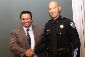 Twin Rivers USD Superintendent Dr. Steven Martinez, left, congratulates Harvey Woo, right, the district's new police chief.