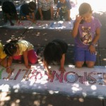 "Youngsters chalk ""Responsibility"" during a Values Project workshop held at Kids Kamp in south Natomas last month. Stencils and chalk will be available for children to chalk in a closed off parking lot at Celebrate Natomas on Sept. 7."
