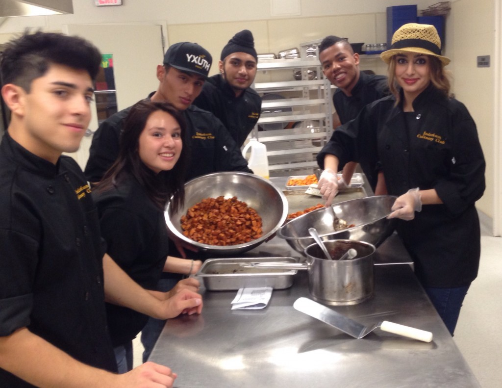 Inderkum High School's culinary club plates dinner for the Natomas Unified school board.