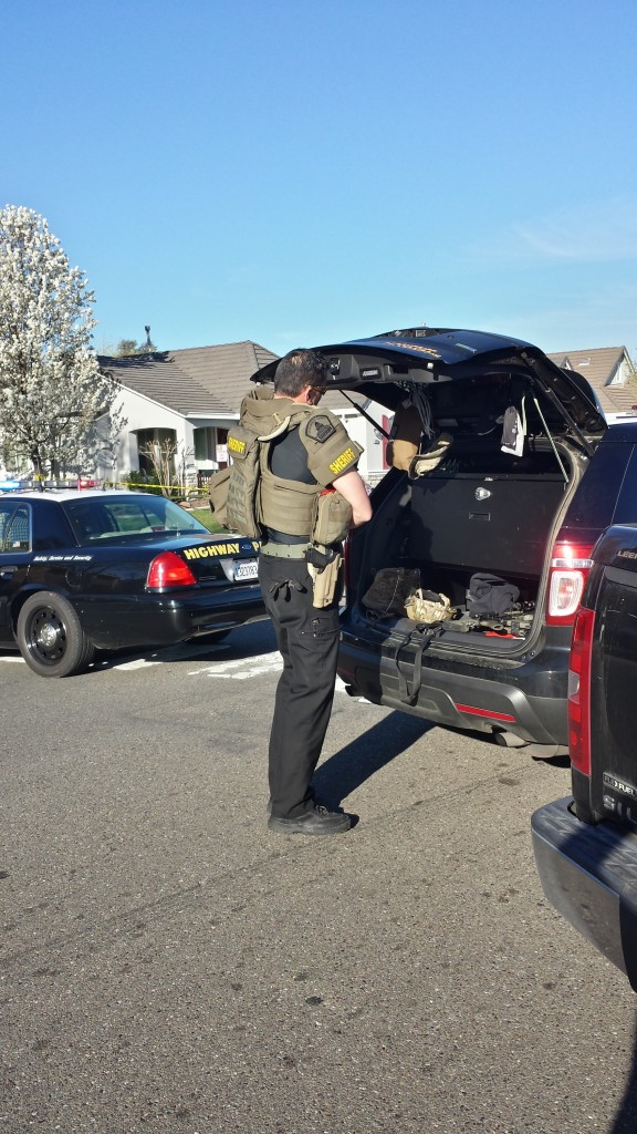 SWAT officers gear up on scene at Bridgecross Way. / Photo: Marc Laver NatomasBuzz.com