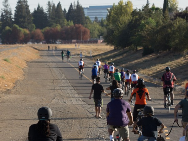 ocal cycling enthusiasts including those from the Heritage Park Bike Club and students from local North Natomas schools, immediately embarked on the trail on foot, bike or scooter after the ceremony concluded. / Photo: NNTMA