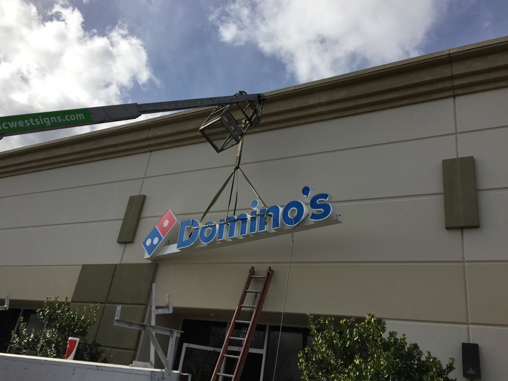 Signage for the new Domino's Pizza went up on Dec. 10. / Photo: B. Cook