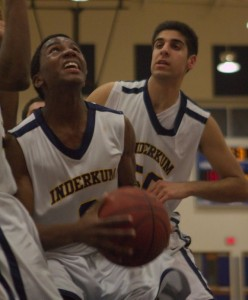 Andrew Ignont (O) grabs a rebound in front of Samer Dhillon (50).