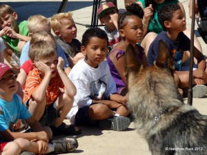 Police dog Bodie visits with Summer Oasis participatns last year. / Photo: C. Shannon