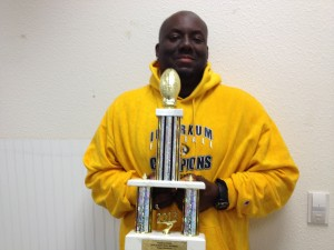 """Inderkum and TMP Elite coach Terrance """"Coach T"""" Leonard with the championship trophy."""