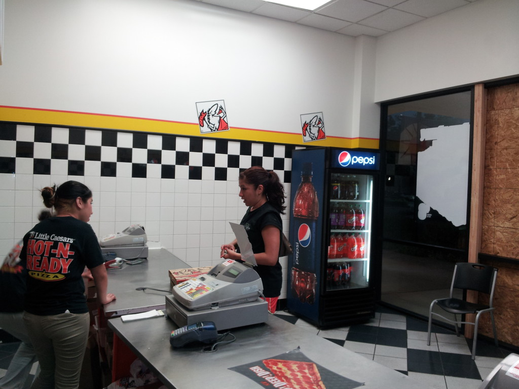 Little Caesar was serving customers 12 hours after a truck crashed through its doors. / Photo by Marc Laver