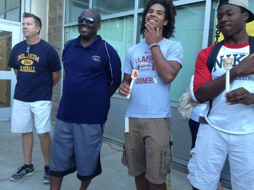 Tears and laughter marked the vigil. JV baseball coach Brian Estensen, JV head football coach Terrance Leonard, CJ Spencer, and Tyler Dean are seen here enjoying a story about Dylan Akins.