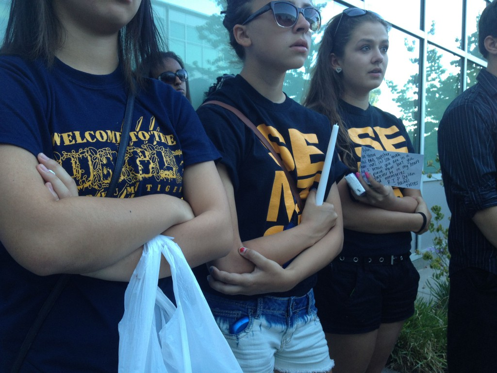 Several class of 2013 graduates were among the mourners at the vigil.