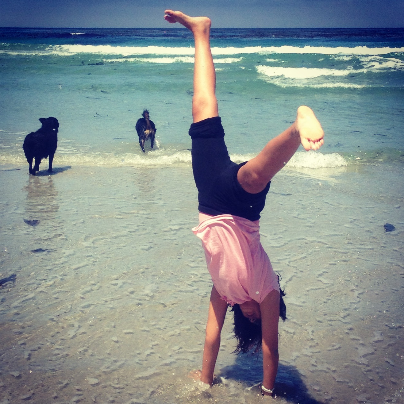 Contest entry: Sofia turns cartwheels in Carmel. Photo by Anthony Edmonds