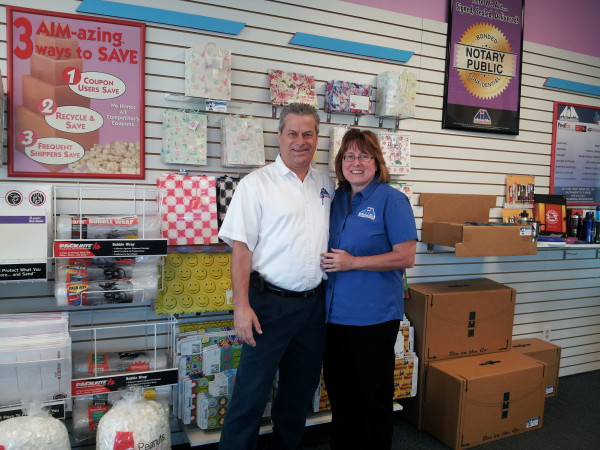 AIM Mail Center owners Dan and Susan Trescott.