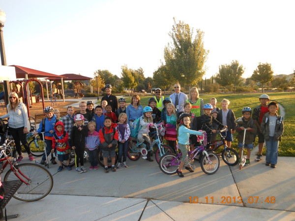 Heron School students assemble at Burberry Park and join the Walking School Bus that meets every Friday. School principal Marci Bernard and Natomas school district administrator Mike Reed also participated in the walk.