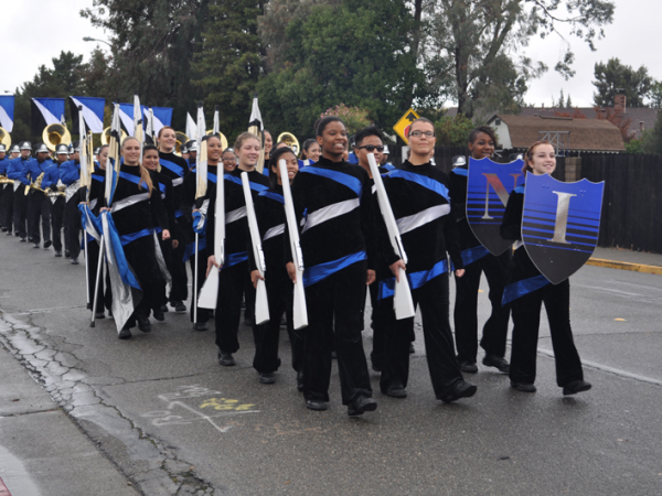 The Color Guard leading the band along the parade route.