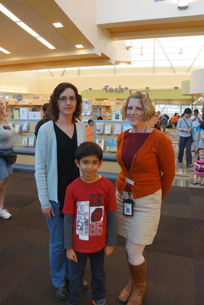 Akshaj Mehta with North Natomas Library staff. / Photo Courtesy Sumiti Mehta