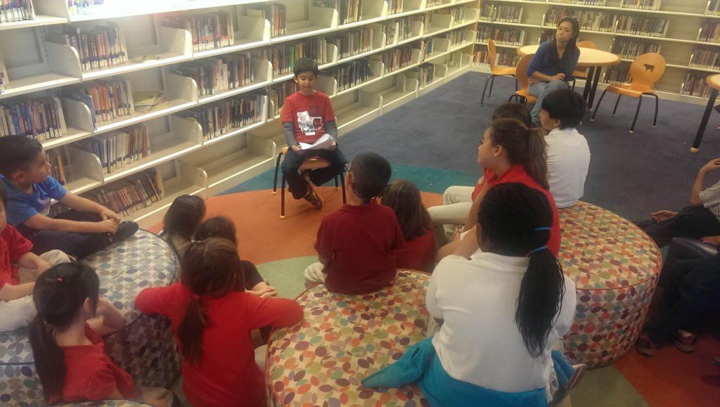 Akshaj Mehta reads to youngsters at the North Natomas Library in November.
