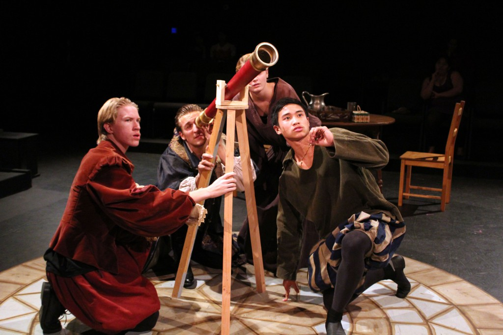 """Students (from left) Jared Unger, Christian Wheeler, Stacy O'Brien, and James Vu perform a scene from """"Galileo,"""" the fall drama production (2012)."""