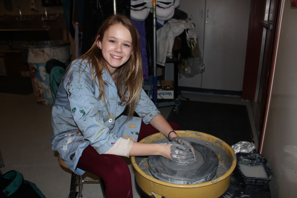 Maria Polzin works with clay on a potters wheel (2013).