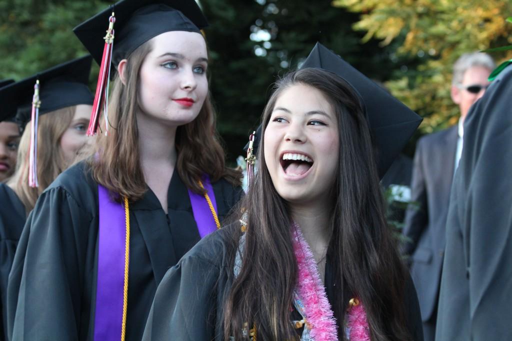 2013 graduates Rachel Chow (front) and Corrie Clapsaddle (back).