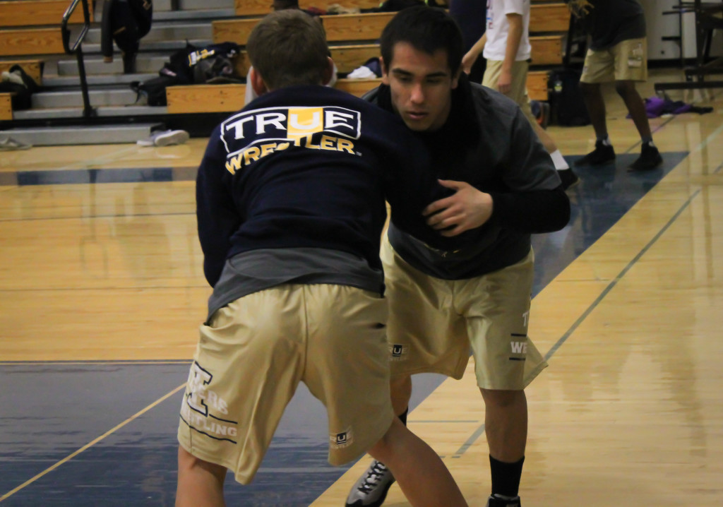Escalante spars with a teammate to warmup for a recent duel match. / Photo: Jeremiah McWright