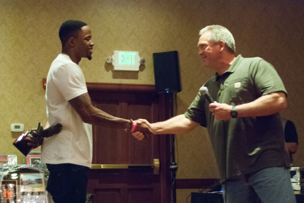 Miami Dolphins wide receiver Marlon Moore with former coach Terry Stark. / Photo by Jeremiah McWright, NHS intern