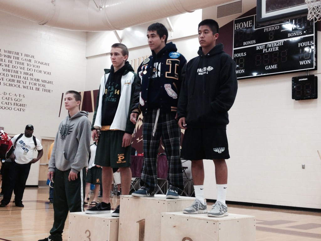 Ruben Escalante, Inderkum senior at 126 pounds, stands on the podium as the Sac-Joaquin Section Division III champion on Saturday at Whitney High School in Rocklin. / Photo: T. Horn