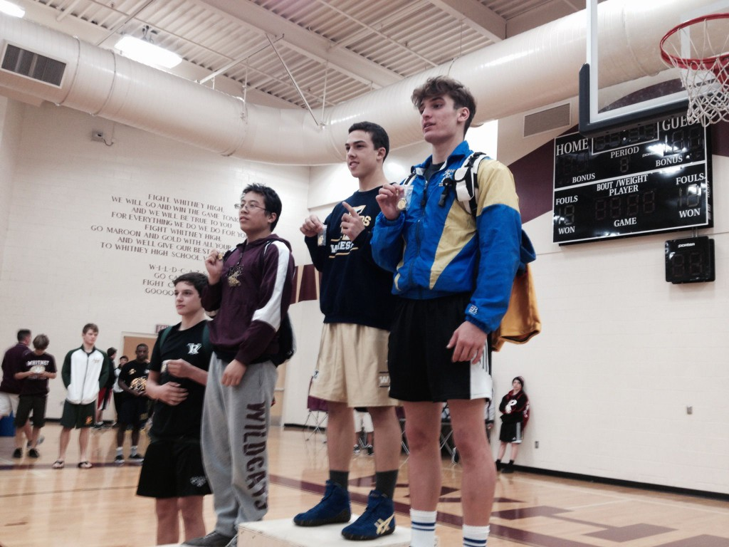 Nicko Chapman, Inderkum sophomore at 152 pounds, stands on the podium as the Sac-Joaquin Section Division III champion on Saturday at Whitney High School in Rocklin. / Photo: T. Horn