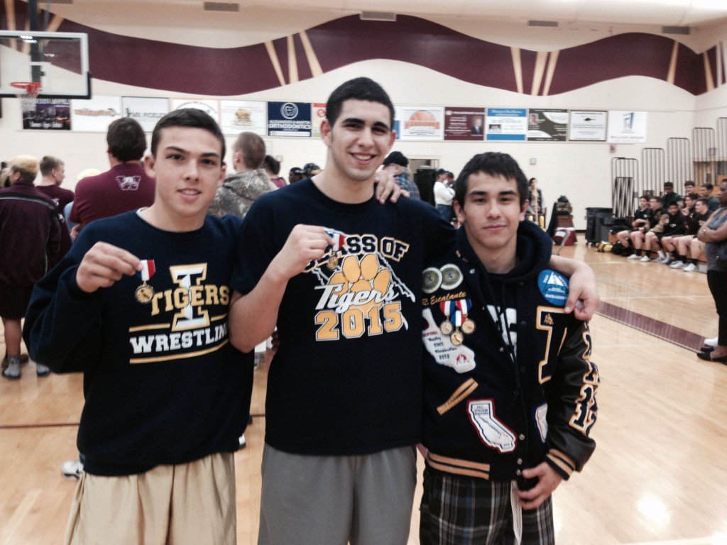 From left, Nicko Chapman (152 pounds), Isaac Mendoza (220) and Ruben Escalante (126) show off their DIII medals as all three become the first Inderkum Divisional champions in school history. / Photo: T. Horn