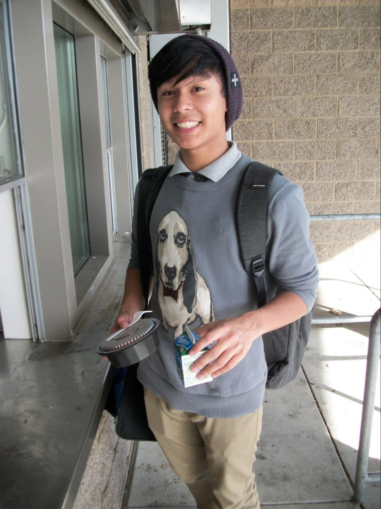 Inderkum sophomore Kenneth Aquino picking up a free meal after school before heading to Jazz rehearsal. / Photo: V. Carrillo