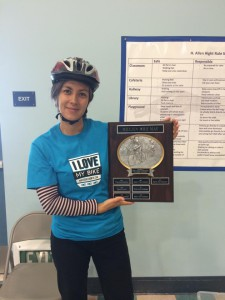 Mellissa Meng shows off the May is Bike Month school plaque.
