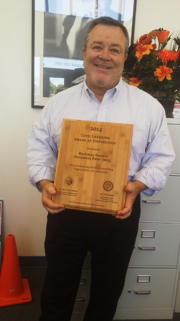 NP3 High School principal Tom Rutten holds the school's second civic engagement award in two years.