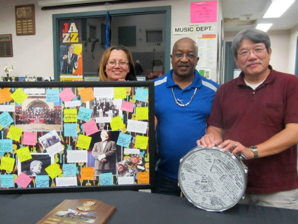 NHS Band Booster President Eddy Kennedy, Floyd Kennedy present Mike Seto with some personalized gifts honoring him on his retirement.  / Courtesy Photo