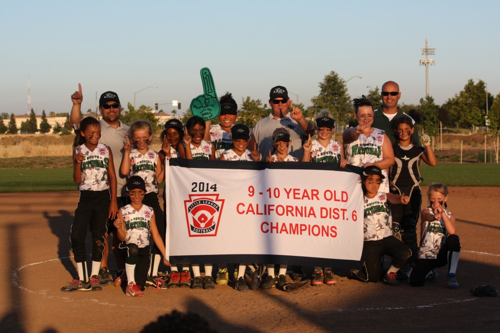 The North Natomas Little League 9-10 Softball team shortly after their win at the District 6 championship against Rio Linda. / Photo: T. Perez