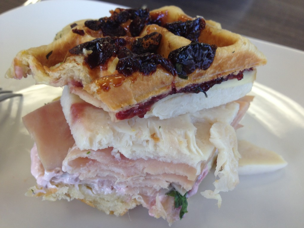 The Full Monte (aka Monte Cristo) features black forest ham, peppered turkey, swiss chard, gouda cheese, tart dried cherry waffle, sour cherry compote. / NatomasBuzz.com