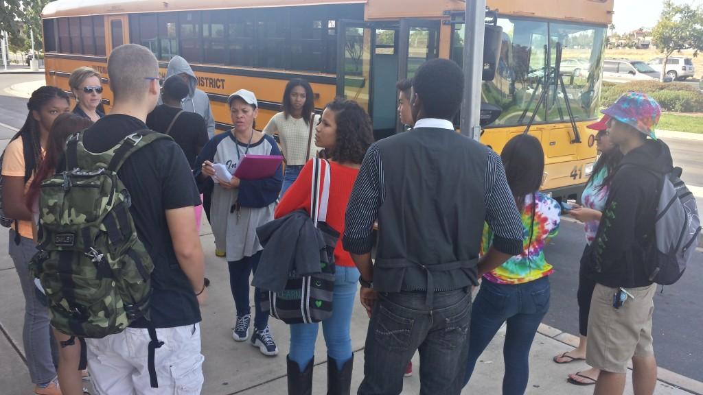 School staff organize students transported to Sleep Train Arena as part of flood evacuation scenario.