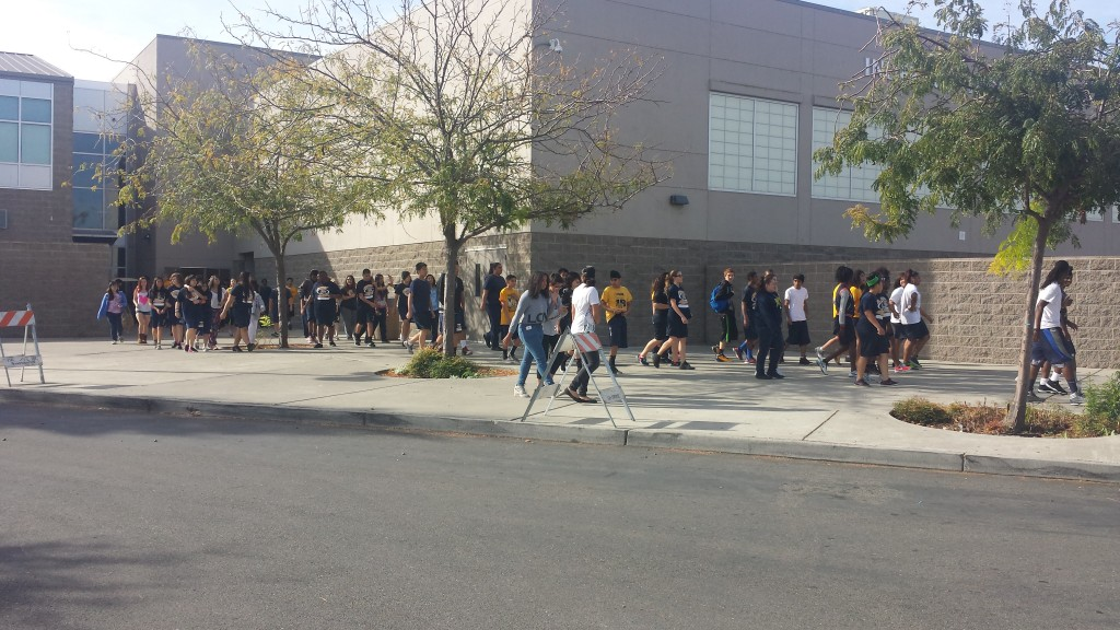 Students evacuate Inderkum High School as part of an earthquake safety drill on Thursday.