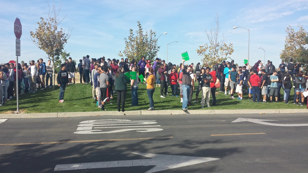 Students congregate in the Inderkum High School parking lot as part of an earthquake safety drill on Thursday.
