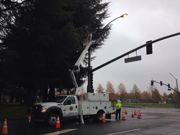City workers remove PODs camera from the corner of San Juan and Truxel roads.