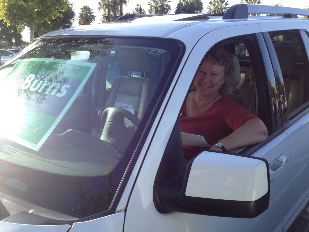 School board candidate takes a break from walking precincts Monday to catch up on phone calls in the Raley's parking lot. / Photo: BTB