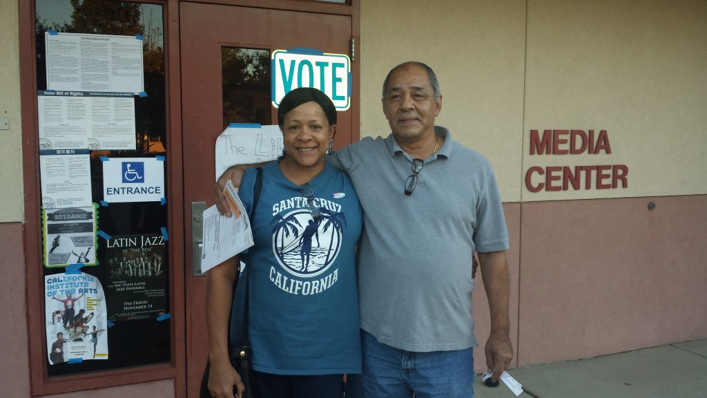 """Tracy and Miguel Spencer.  Her quote was: """"It is my duty as a citizen to vote. I am voting to elect more Democrats in all offices""""."""