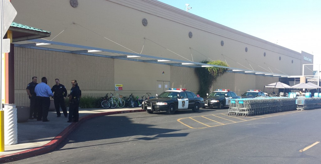 Walmart General Manager Franklin Jackson speaks with Sacramento Police shortly after bomb threat at the store. / Photo: Marc Laver
