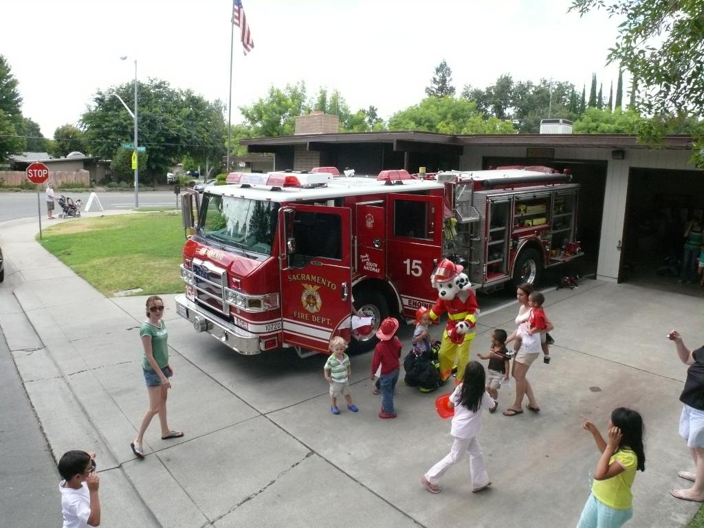 Image of the fire station with a fire engine parked in the driveway.