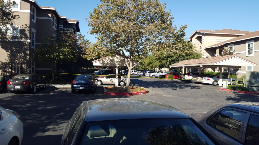 Crime Scene Investigators on the scene at Natomas Park Apartments. / Photo: Marc Laver