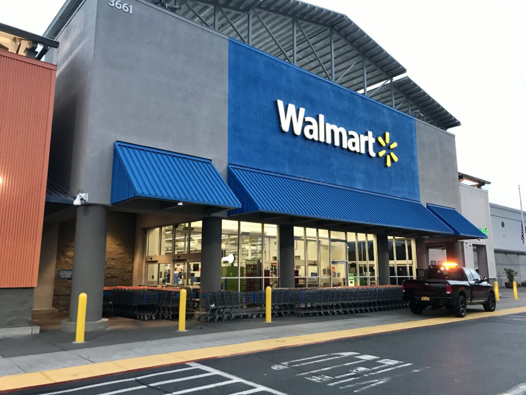 Image of Walmart storefront in Natomas with shopping carts barricading the outer doors.