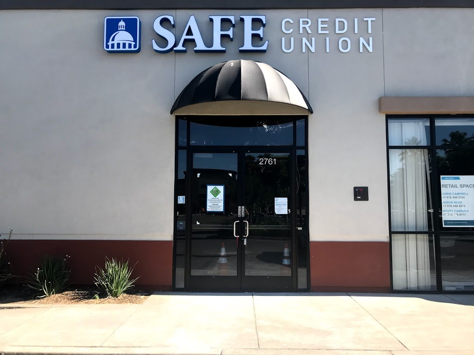 Image of front of building with words Safe Credit Union and logo.