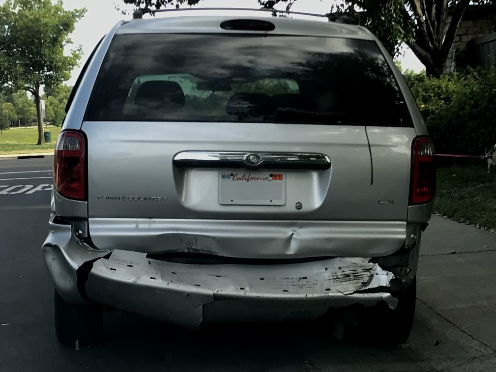 Image of damaged mini van.