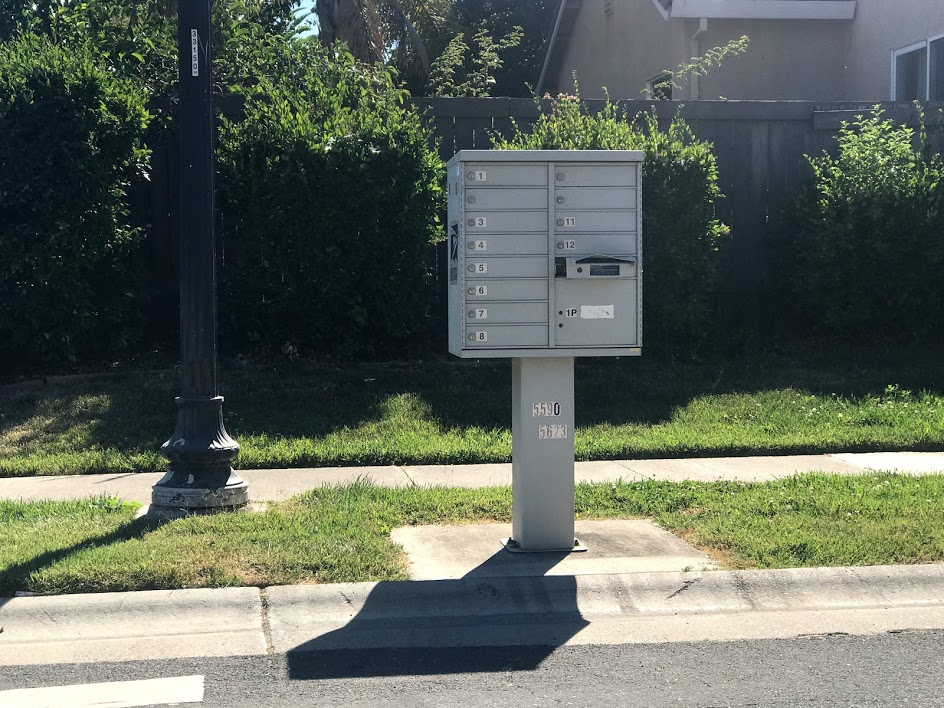Image of vandalized cluster mailbox.