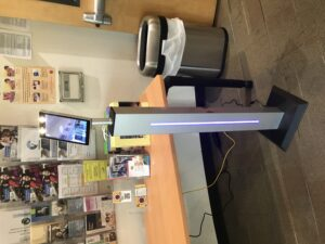 Image of standing temperature machine with light up screen.