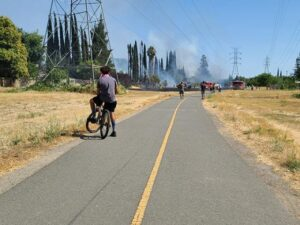 Image of bike trail with smoke on horizon.
