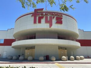 Image of Fry's Electronics storefront with boards covering what would be the entrance doors.